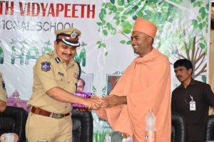 Saints of Swamy Narayan presented Memento to MAHESH. M. BHAGWAT, COMMISSIONER OF POLICE